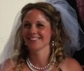 A photo of a happy bride at St Michael's, Offham