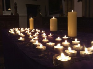 A photo of the candle tributes at the Memorial Service 2012