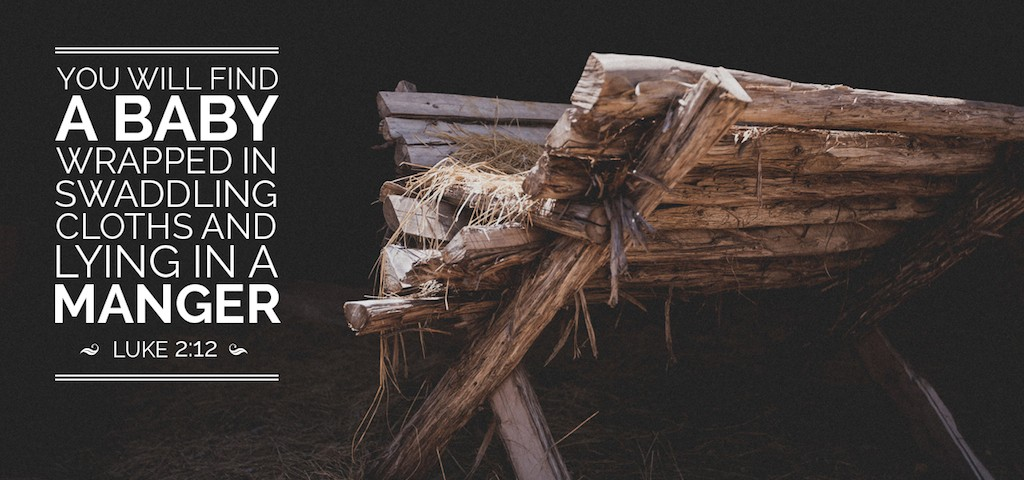 A Christmas photo of a manger with the text from Luke 2:12