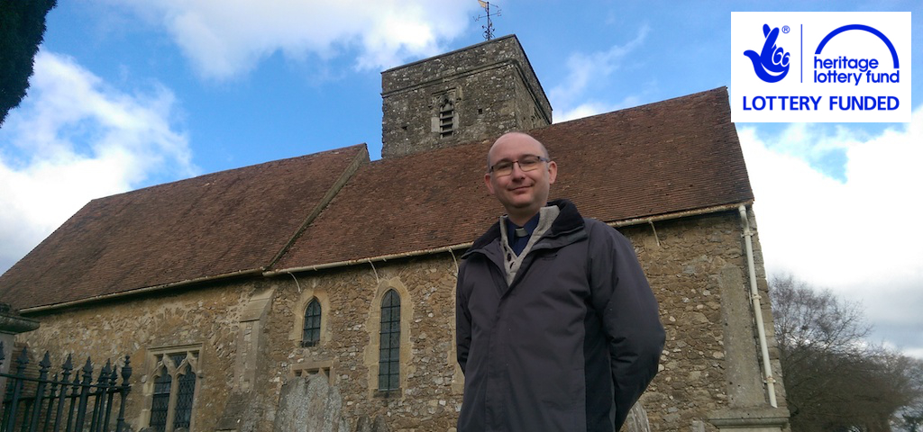 Our minister David stands outside St Michael's, Offham