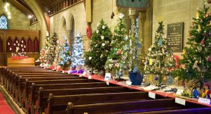 Photo of a church with Christmas Trees festival
